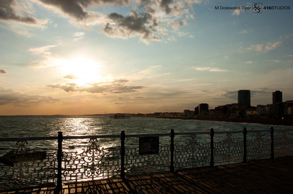 sunset blue sky Brighton Pier view skyline horizon orange clouds coast coastal city