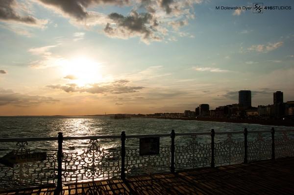 sunset blue sky Brighton Pier view skyline horizon orange clouds coast coastal city