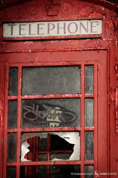 vandalised red phone booth