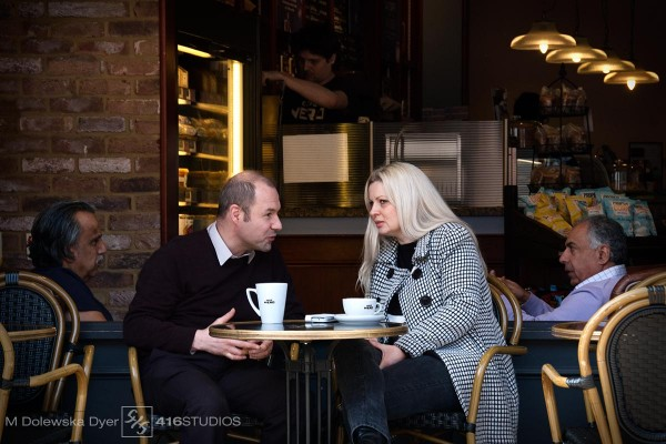street photography couple in the cafe gossip over coffee lifestyle shot